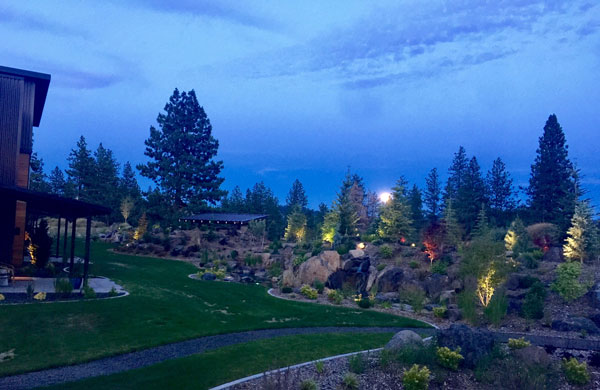 Spokane South Hill townhomes offer night views of the garden.