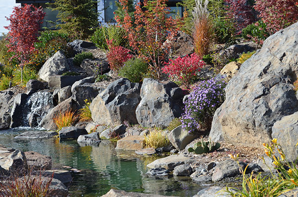 Waterfalls, babbling brooks, ponds, and colorful flowers provide a feeling of tranquility.